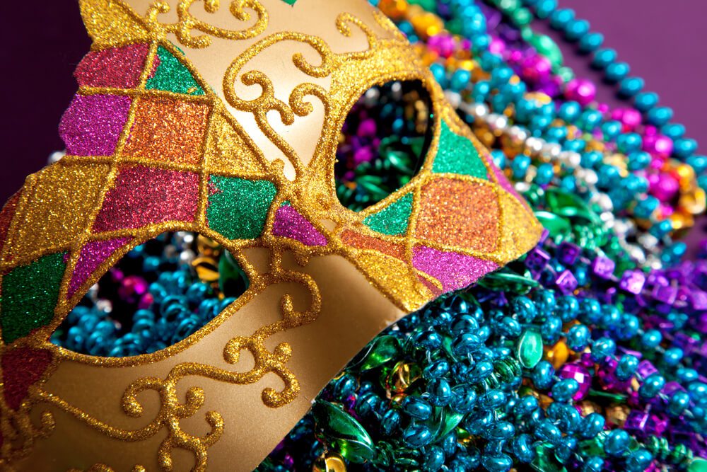 mardi gras mask in purple, gold and green