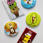 4 fridge magnets featuring sloths and skull ice cream cones on a fridge