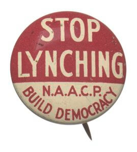red and white button with stop lynching n.a.a.c.p build democracy