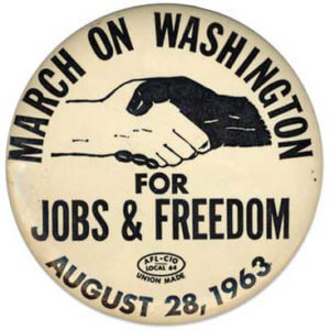 march on washington black and white hands in handshake