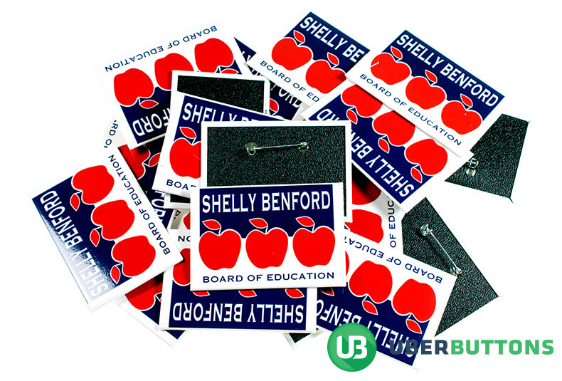 shelly benford board of education. white with blue background and red apples