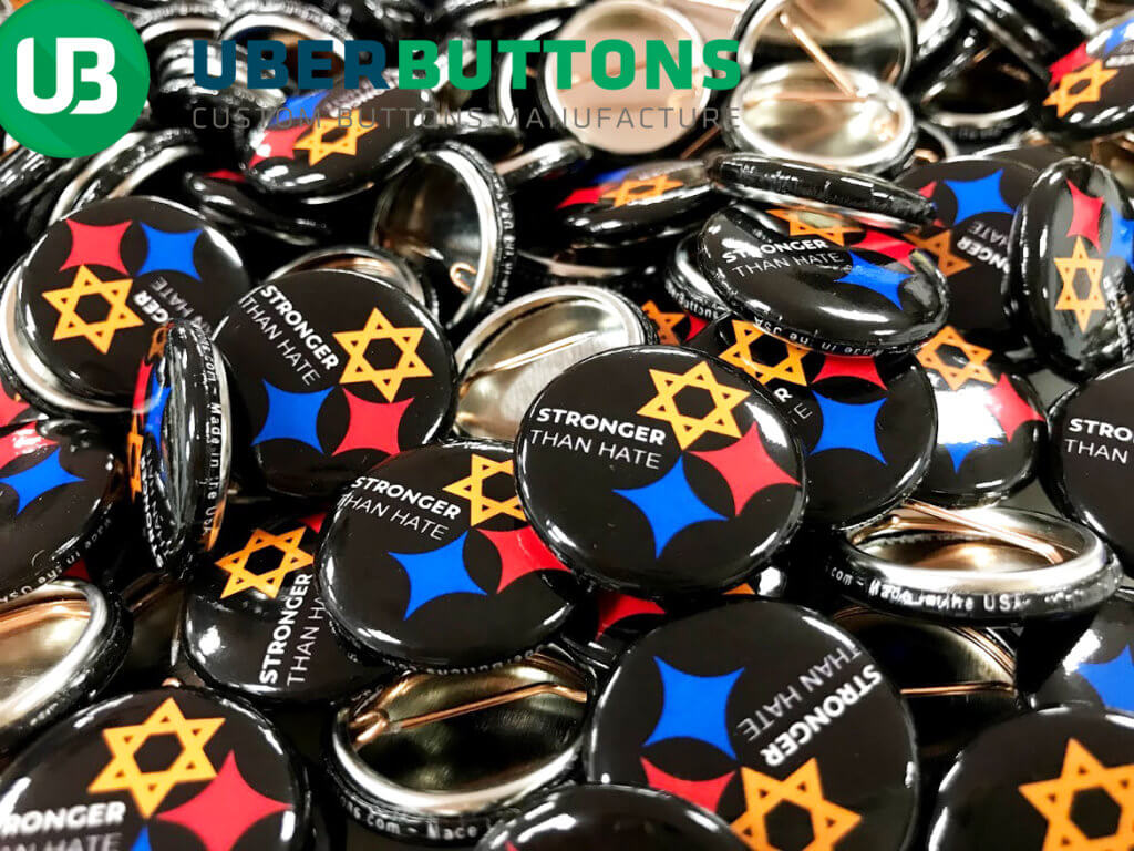 Tree of Life Synagogue support buttons - giant heap of buttons with the Stronger than Hate logo